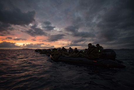 U.S. Marines assigned to Company F, Battalion Landing Team 2nd Battalion, 4th Marines, 31st Marine Expeditionary Unit, maneuver with combat rubber raiding craft while participating in an amphibious night raid off the coast of Camp Courtney, Okinawa, Japan, Sept. 3, 2016. As the Marine Corps' force-in-readiness in the Asia-Pacific region, the 31st MEU trains in a number of unique capabilities for rapid crisis response. (U.S. Marine Corps photo by Cpl. Darien J. Bjorndal, 31st Marine Expeditionary Unit/ Released)