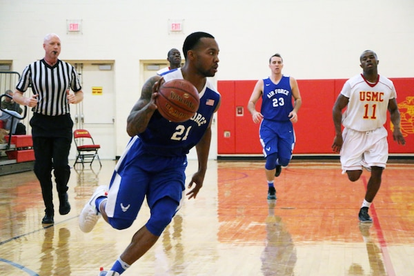 Senior Airman Daveon Allen of Nellis AFB, Nevada drives the lane during the 2016 Armed Forces Men's Basketball Championship held at MCB Quantico, Va. from 1-7 November.  Air Force won the first contest 66-62 over the Marines.  The best two teams during the doubel round robin will face each other for the 2016 Armed Forces crown.