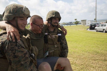 WHITE BEACH NAVAL STATION, Okinawa, Japan, (Sept. 4, 2016) – Marines with Combat Logistics Battalion 31, 31st Marine Expeditionary Unit, carry a wounded role-player evacuated from the U.S. Consulate on Okinawa, Japan, during noncombatant evacuation operations training at White Beach Naval Station, Okinawa, Sept. 4, 2016. Noncombatant evacuation operations are a key facet of the 31st MEU's capabilities as part of the Bonhomme Richard Expeditionary Strike Group. The 31st MEU, currently embarked aboard the ships of the BHR ESG, combines air-ground-logistics into a single unit with one commander, and is task-organized to address a wide variety of military operations in the Asia-Pacific region, from force projection and maritime security to humanitarian assistance and disaster relief. (U.S. Marine Corps photo by Lance Cpl. Jorge A. Rosales/released)