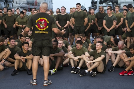 Sgt. Maj. Jim Lanham, sergeant major, 31st Marine Expeditionary Unit, speaks to a formation of 31st MEU noncommissioned officers on the flight-deck of the USS Bonhomme Richard (LHD 6) after taking part in physical training, Sept. 13. The 31st MEU is the Marine Corps' only continuously forward-deployed Marine Air-Ground Task Force, and combines air-ground-logistics into a single team capable of addressing a range of military operations in the Asia-Pacific region – from force projection and maritime security to humanitarian assistance and disaster relief in cooperation with host countries and partner militaries. (U.S. Marine Corps Photo by Staff Sgt. T.T. Parish/Released)