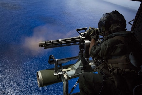 Cpl. Cristina Fuentes, a UH-1Y Venom helicopter crew chief assigned to Marine Medium Tiltrotor Squadron 262 (Reinforced), 31st Marine Expeditionary Unit, fires a GAU-17/A minigun during a fire support training exercise (FISTEX) over Farallon De Medinilla, Commonwealth of the Northern Mariana Islands, Sept. 16, 2016. Marines with VMM-262 (Rein.) conducted the FISTEX as a part of Valiant Shield 16. Valiant Shield 16 is a biennial, U.S.-only, field training exercise with a focus on integration of joint training among U.S. forces. This training enables real-world proficiency in sustaining joint forces through detecting, locating, tracking and engaging units at sea, in the air, on land, and in cyberspace in response to a range of mission areas. (U.S. Marine Corps photo by Cpl. Darien J. Bjorndal/Released)