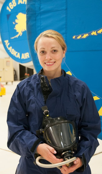 Staff Sgt. Julia Meyer, a fuels systems mechanic with the 168th Maintenance Squadron, holds her respirator while dressed in waterproof overalls inside the unit's fuel cell at Eielson AFB, Alaska, October 18, 2016. Meyer is a fulltime technician with the Interior-Alaska unit and was recognized for her outstanding technical abilities during a recent deployment to Southwest Asia. (U.S. Air National Guard photo by Senior Master Sgt. Paul Mann/Released)