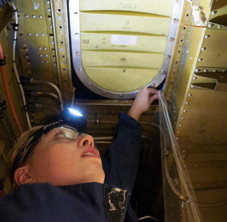Staff Sgt. Julia Meyer, a fuels systems mechanic with the 168th Maintenance Squadron, finishes the lacing for the fuel system zero-cell access area of the KC-135R inside the unit's fuel cell hangar at Eielson AFB, Alaska, October 18, 2016. Meyer is a fulltime technician with the Interior-Alaska unit and recently returned home from her third deployment to Southwest Asia. (U.S. Air National Guard photo by Senior Master Sgt. Paul Mann/Released)