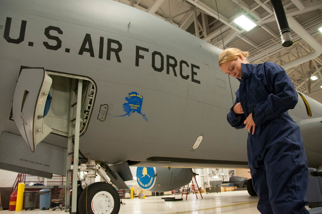 Staff Sgt. Julia Meyer, a fuels systems mechanic with the 168th Maintenance Squadron, dresses in waterproof overalls as she prepares to inspect part of the KC-135R fuel system inside the unit's fuel cell at Eielson AFB, Alaska, October 18, 2016. Meyer is a fulltime technician with the Interior-Alaska unit and recently returned home from her third deployment to Southwest Asia. (U.S. Air National Guard photo by Senior Master Sgt. Paul Mann/Released)