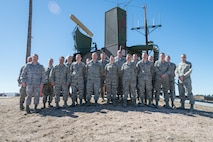 U.S. Air Force Airmen assigned to the 243rd Air Traffic Control Squadron, Wyoming Air National Guard pose in front of a radar antenna March 10, 2015, near Cheyenne Regional Airport in Cheyenne, Wyoming. Members of the Radar and Approach Control (RAPCON) were awarded the D. Ray Hardin Air Traffic Control Facility of the Year award for 2014. (U.S. Air National Guard photo by Master Sgt. Charles Delano/released)