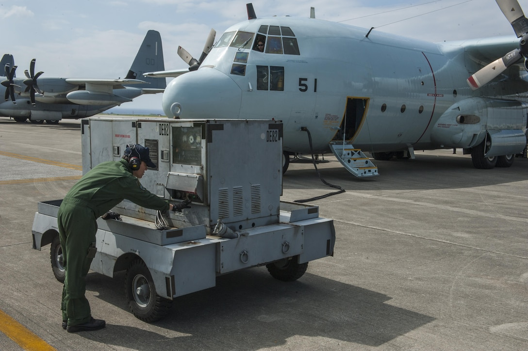 A member of the Japan Air Self-Defense Force operates a ground power unit for a JASDF C-130 Globemaster taking part in Exercise Keen Sword Oct. 30, 2016, on the flightline at Kadena Air Base, Japan. Keen Sword is a multi-phase exercise which involves multiple bases and branches from across the Indo-Asian Pacific Theater. (U.S. Air Force photo by Airman 1st Class Nick Emerick /Released)