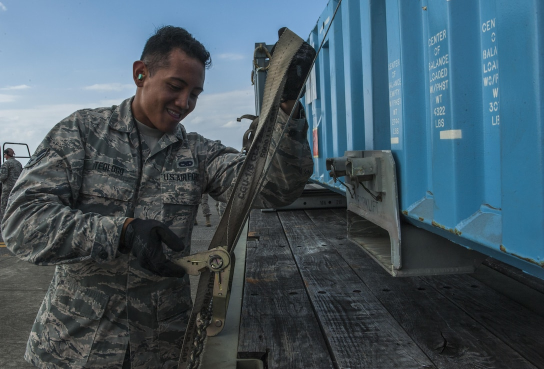 U.S. Air Force Airman 1st Class Ryan Teologo, a munitions storage crew member with the 18th Munitions Squadron, secures mock munitions for transport to a storage area Oct. 30, 2016, at Kadena Air Base, Japan. With operations such as these, the 18th MUNS is able to demonstrate the truly broad range of capabilities they have. (U.S. Air Force photo by Airman 1st Class Nick Emerick /Released)