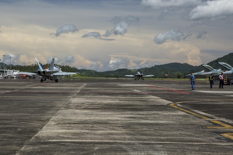 Two U.S. Marine Corps F/A-18D Hornets with Marine All-Weather Fighter Attack Squadron (VMFA (AW)) 225, taxi down the flight line to begin exercise Cope West 17 at Sam Ratulangi International Airport, Indonesia, Nov. 1, 2016. This fighter-focused, bilateral exercise between the U.S. Marine Corps and Indonesian Air Force is designed to enhance the readiness of combined interoperability between the two nations. The squadron plans to complete their unit air-to-air training requirements, which focuses on basic fighter maneuvering, section engaged maneuvering, offensive anti-air warfare and active air defense versus the Indonesian Air Force to increase situational readiness, interoperability, knowledge and partnership between the U.S. and Indonesia. (U.S. Marine Corps photo by Cpl. Aaron Henson)