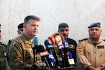 U.S. Air Force Col. John Dorrian, Combined Joint Task Force - Operation Inherent Resolve spokesman, addresses the media during a joint press conference at Makhmur, Iraq, Nov. 1, 2016. Reporters were updated about the ongoing operations in the fight against ISIL. (U.S. Army photo by Spc. Ian Ryan)