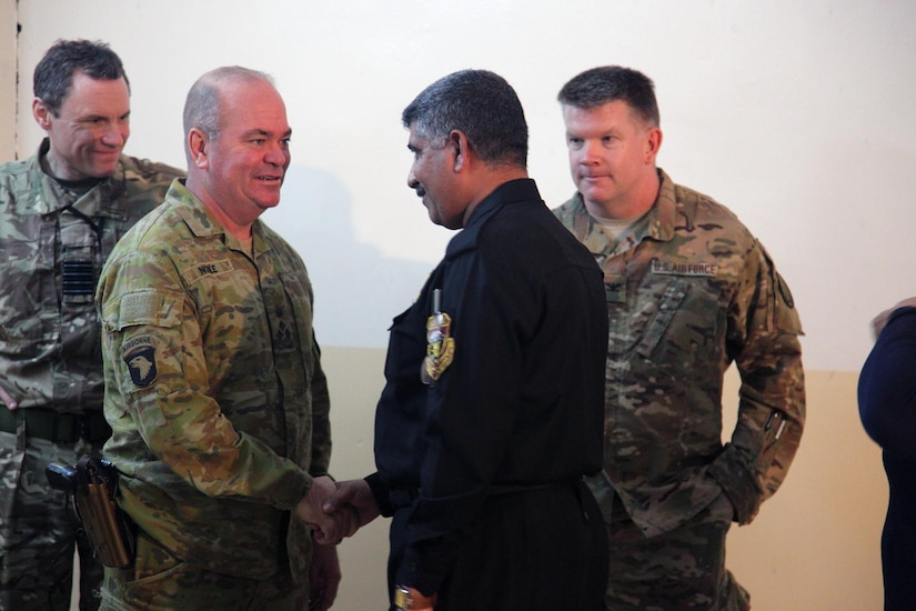 Australian Brig. Gen. Roger Noble, deputy commanding general for Combined Joint Forces Land Component Command – Operation Inherent Resolve, greets an Iraqi police officer after a joint press conference at Makhmur, Iraq, Nov. 1, 2016. Reporters were updated about the ongoing operations in the fight against ISIL. (U.S. Army photo by Spc. Ian Ryan)