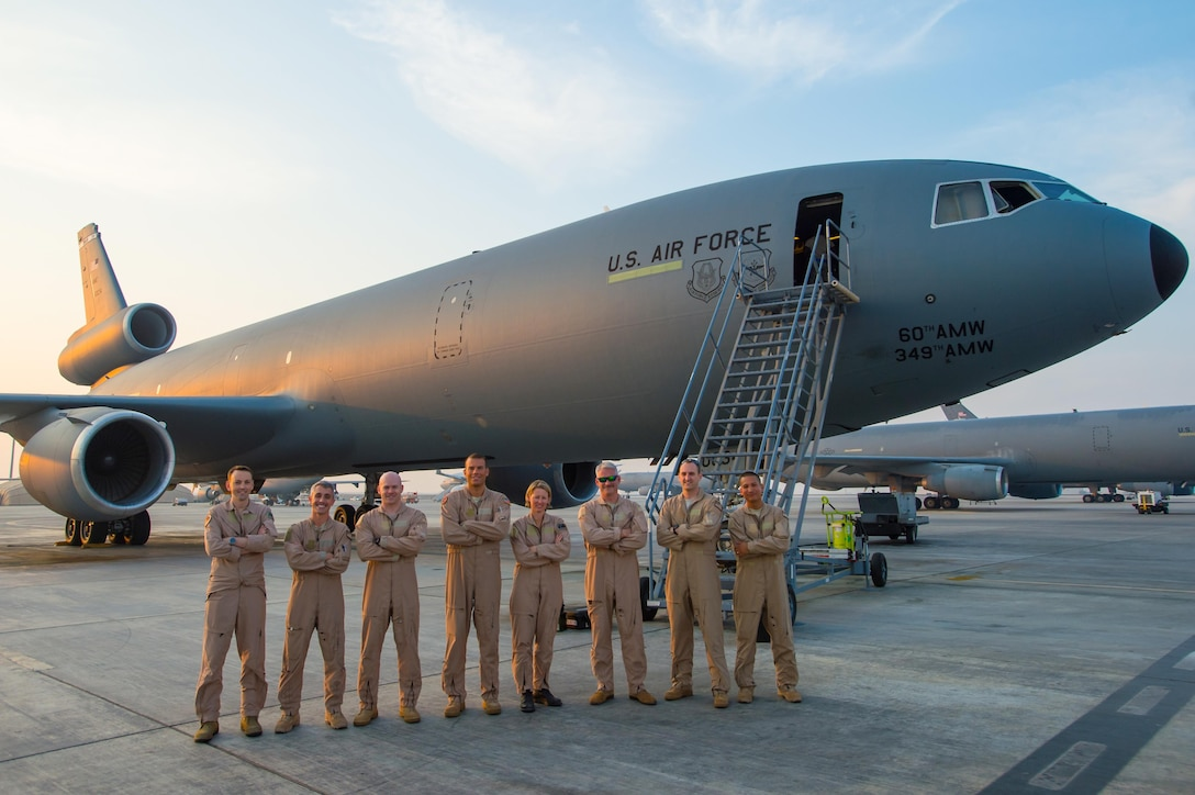A U.S. Air Force KC-10 Extender crew and a Royal Australian Air Force KC-30A crew pose for a photo after completing the first ever coalition formation departure at an undisclosed location in Southwest Asia, Oct. 25, 2016. Between the two air craft, they had the capability to collectively travel more than 20,000 miles in a joint effort to refuel allied air craft in support of the liberation of Mosul, Iraq. (U.S. Air Force photo by Senior Airman Tyler Woodward)