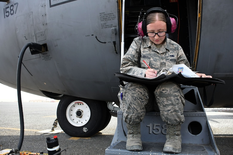 Senior Airman Colleen Sweeney-Marple, a 386th Expeditionary Aircraft Maintenance Squadron assistant dedicated crew chief, examines a checklist at an undisclosed location in Southwest Asia Nov. 1, 2016. Senior Airman Colleen Sweeney-Marple is deployed from the 755th Aircraft Maintenance Squadron at Davis-Monthan Air Force Base, Ariz. (U.S. Air Force photo by Senior Airman Andrew Park/Released)