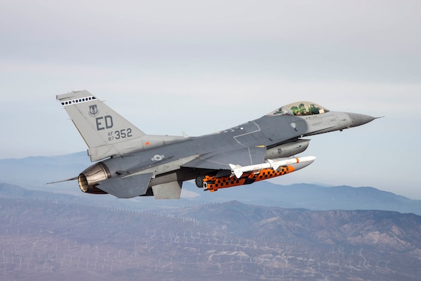 A U.S. Air Force F-16 Fighting Falcon piloted by Maj. Jameel Janjua of the Royal Canadian Air Force carries a developmental test version of the Joint Strike Missile to its release point above the Utah Test and Training Range west of Salt Lake City, Utah. When development is complete, the Joint Strike Missile is intended for use aboard the F-35 Lighting II Joint Strike Fighter. Janjua is assigned to the 416th Flight Test Squadron based at Edwards as part of an officer exchange program. (U.S. Air Force photo by Christopher Okula)
