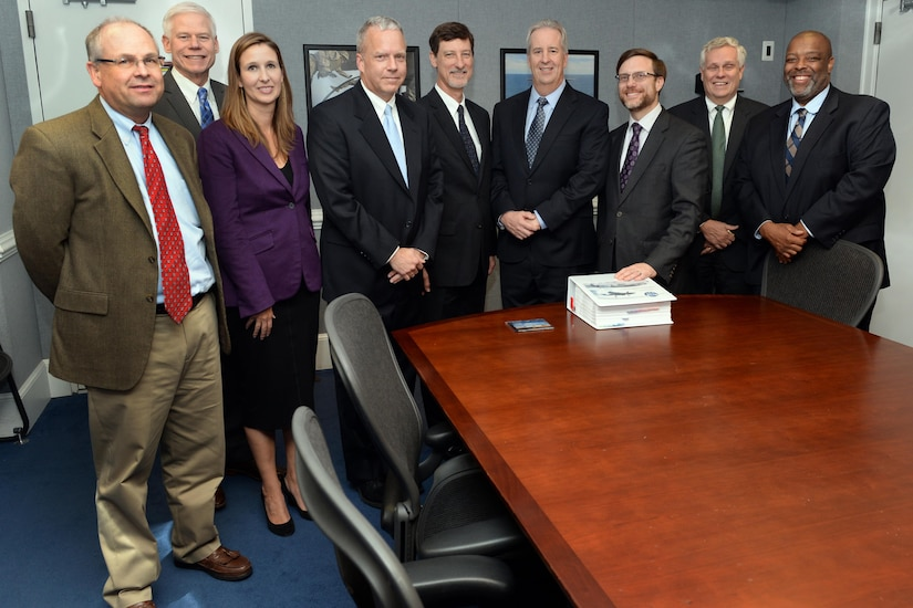 Director of cost Assessment and Program Evaluation Jamie Morin, third from left, stands with Pentagon and contractor Lockheed Martin representatives after a briefing about a new jointly developed F-35 cost tracking software at the Pentagon in Arlington, Va. Nov. 1, 2016. (DoD photo by EJ Hersom)