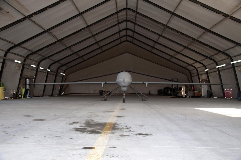 A MQ-1 Predator sits in the hangar in an undisclosed location in Southwest Asia, Oct. 20, 2016. The 386th Air Expeditionary Wing beds down and supports the MQ-1 in order to gather intelligence, surveillance and reconnaissance, and perform strike missions. (U.S. Air Force photo by Master Sgt. Anika Jones/Released)