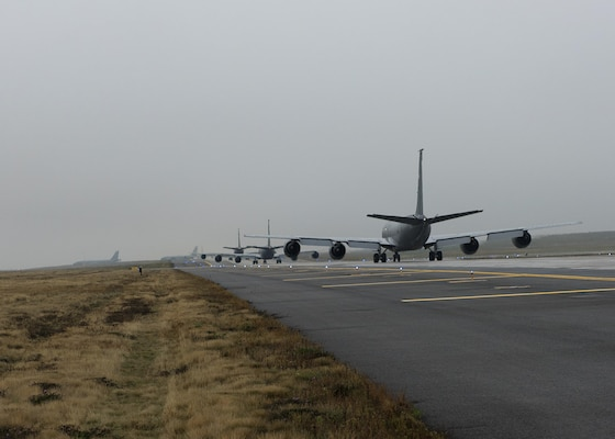 Five KC-135R Stratotankers from the 92nd Air Refueling Squadron make a line on the runway at Fairchild Air Force Base, Wash., Oct. 30, 2016. The KC-135 can do more than refuel, as it is also capable of transporting litter and ambulatory patients using patient support pallets during aeromedical evacuations. (U.S. Air Force photo by Airman 1st Class Ryan Lackey)