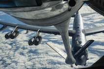 A KC-135 Stratotanker prepares to refuel a B-52 Stratofortress in midair over the United States Oct. 30, 2016, as part of Exercise Global Thunder. Exercise Global Thunder provides training opportunities for USSTRATCOM components, task forces, units and command posts to deter and, if necessary, defeat a military attack against the United States and to employ forces as directed by the President.This tanker refueled two B-52s on this mission. (U.S. Air Force photo/Tech. Sgt. Travis Edwards)
