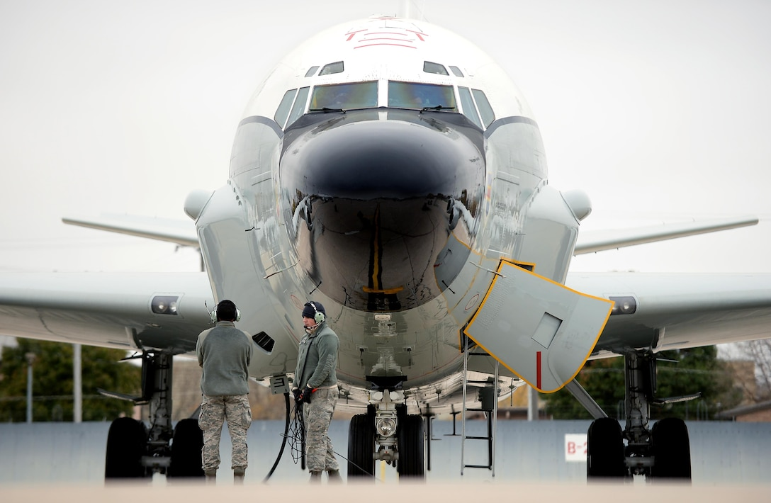Staff Sgt. Riley Neads and Airman First Class Kejion Madden-Vaughn, crew chiefs with the 55th Maintenance Group, prepare to launch an RC-135 V/W Rivet Joint aircraft during Global Thunder 17, U.S. Strategic Command's annual command post and field training exercise, Oct. 30, 2016, at Offutt Air Force Base, Neb. The exercise provided training opportunities for USSTRATCOM-tasked components, task forces, units and command posts to deter and, if necessary, defeat a military attack against the United States and to employ forces as directed by the President. (U.S. Air Force Photo by Delanie Stafford)