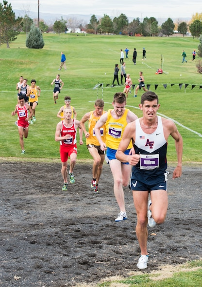 Cadet Andrew Milliron runs up a hill in the Mountain West Conference Championship Oct. 28, 2016, at the Falcon Crest Golf Club in Kuna, Idaho. Milliron placed 29th overall out of 66 runners in the eight-kilometer course in 25 minutes, 2.30 seconds. (U.S. Air Force photo by Airman 1st Class Chester Mientkiewicz/Released)