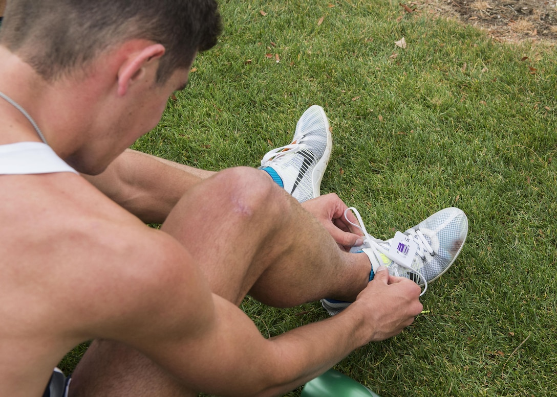Cadet Andrew Milliron removes his chip after running in the Mountain West Conference Championship Oct. 28, 2016, at the Falcon Crest Golf Club in Kuna, Idaho. Milliron placed 29th overall out of 66 runners in the eight-kilometer course in 25 minutes, 2.30 seconds. (U.S. Air Force photo by Airman 1st Class Chester Mientkiewicz/Released)