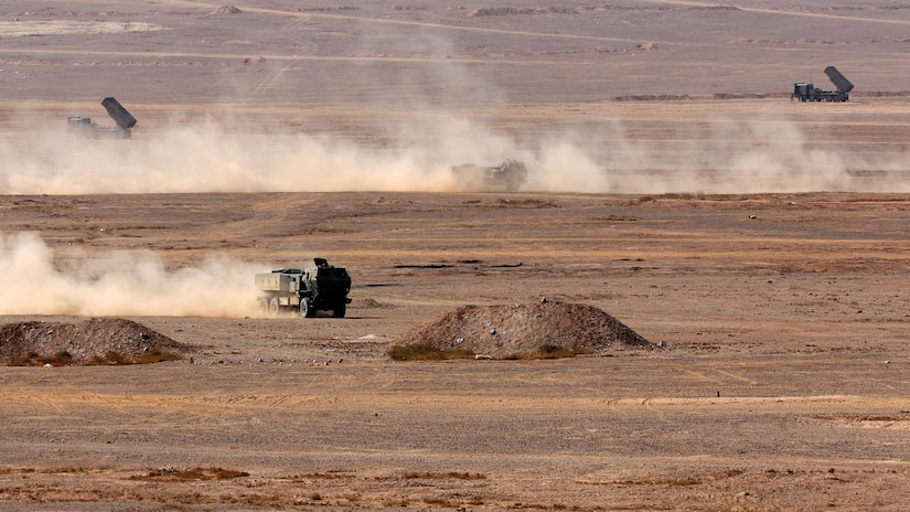 Soldiers from the Jordanian Army's 29th Royal HIMARS Battalion and the U.S. Army's 3rd Battalion, 321st Field Artillery Regiment conduct a quick turn-around during a live-fire exercise October 25. The two nations continue to partner to ensure interoperability.