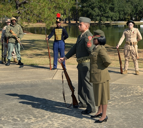 Marines showcase various uniforms throughout Marine Corps history during a birthday pageant at Covella Pond aboard Marine Corps Logistics Base Albany, Nov. 1.