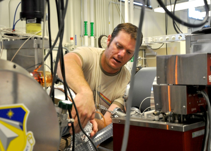 Air Force Research Laboratory scientist Oscar Martinez works on a turbomolecular pump in the Space Vehicles Directorate's Plasma Lab. Martinez recently took part in a unique 10-day event called AFRL 2016 TECH Warrior. The purpose of the course is to give AFRL scientists and engineers an immersive experience in a full operational field exercise.
