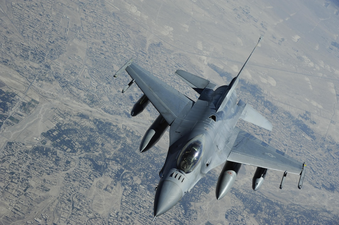 An F-16 Fighting Falcon approaches the boom of a KC-135 Stratotanker during a refueling mission, Oct. 28, 2016, at an undisclosed location within the Central Command Area of Responsibility. Airmen of the 379th Air Expeditionary Wing watched this refueling mission during an incentive flight, organized to show how their job plays a vital role in supporting the flying mission. (U.S. Air Force Photo by Senior Airman Cynthia A. Innocenti)