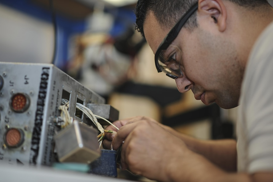 Staff Sgt. Vincent Cruz, 355th Maintenance Group Air Force repair enhancement technician, solders a replacement relay for an armament relay box that controls some of the A-10 weapons systems at Davis-Monthan Air Force Base, Ariz., Oct. 25, 2016. D-M's AFREP possesses a repair rate of 95 percent and a financial benefit of over two million dollars. (U.S. Air Force photo by Airman 1st Class Mya M. Crosby)