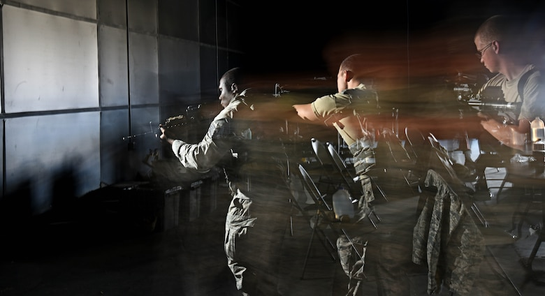 Airmen assigned to the 799th Security Forces Squadron practice procedures in clearing a room, Oct. 21, 2016, at Range 63C, Silver Flag Alpha, Nev. The training focused on a team's ability to simultaneously move and communicate through hand gestures and tactical verbiage while entering, securing and exiting a room. (U.S. Air Force photo by Airman 1st Class James Thompson)