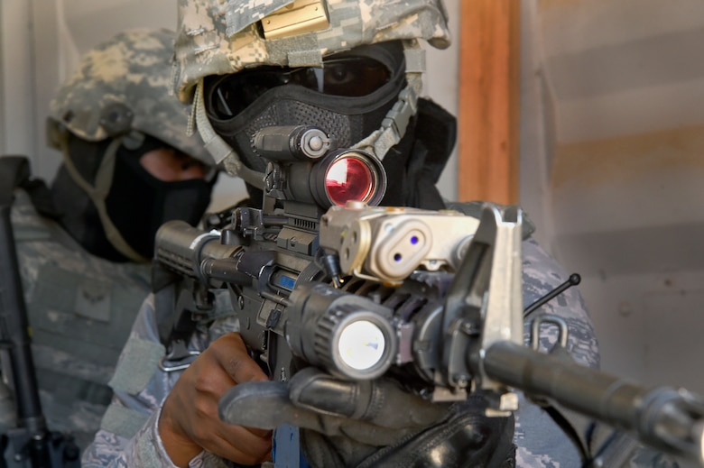 An Airman assigned to the 799th Security Forces Squadron secures an entrance point during a Fundamentals of Proficiency Fire and Close Quarters Battle course, Oct. 21, 2016, at Range 63C, Silver Flag Alpha, Nev. Airmen were evaluated on their planning, communication, teamwork, execution and effectiveness during simulated operations. (U.S. Air Force photo by Airman 1st Class James Thompson)