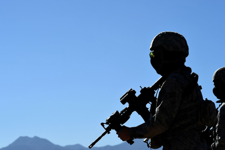 Airmen assigned to the 799th Security Forces Squadron travel to a designated training site to begin a field training exercise in a Fundamentals of Proficiency Fire and Close Quarters Battle course, Oct. 21, 2016, at Range 63C, Silver Flag Alpha, Nev. The unit was divided into Alpha, Bravo, and Charlie flights, each with designated squad and fire team leaders. (U.S. Air Force photo by Airman 1st Class James Thompson)