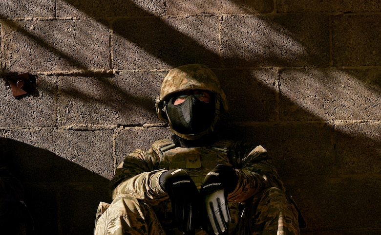 An Airman assigned to the 799th Security Forces Squadron rests after becoming a casualty during a simulated combat scenario, Oct. 21, 2016, at Range 63C, Silver Flag Alpha, Nev. The Airmen were tasked with planning and carrying out specific operation orders while mitigating collateral damage and neutralizing all opposing forces. (U.S. Air Force photo by Airman 1st Class James Thompson)