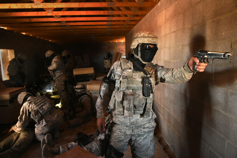 An Airman assigned to the 799th Security Forces Squadron defends his unit's position from opposing forces during the field training exercise of a Fundamentals of Proficiency Fire and Close Quarters Battle course, Oct. 21, 2016, at Range 63C, Silver Flag Alpha, Nev. Airmen were tested and evaluated in combat tactics, strategic planning, communication and leadership through various training scenarios. (U.S. Air Force photo by Airman 1st Class James Thompson)