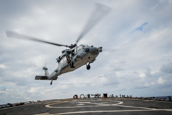 "An MH-60S Sea Hawk helicopter assigned to the ""Golden Falcons"" of Helicopter Sea Combat Squadron (HSC) 12 takes off from the flight deck of the forward-deployed Arleigh Burke-class guided-missile destroyer USS Barry (DDG 52) after refueling during Keen Sword 17 (KS17), Nov. 1, 2016. KS17 is a biennial, Chairman of the Joint Chiefs of Staff-directed, U.S. Pacific Command-sponsored Field Training Exercise (FTX). KS17 is a joint/bilateral FTX designed to meet mutual defense objectives by increasing combat readiness and interoperability between Japan Self-Defense Forces (JSDF) and U.S. Forces. Barry is on patrol with Carrier Strike Group Five (CSG 5) in the Philippine Sea supporting security and stability in the Indo-Asia-Pacific region."