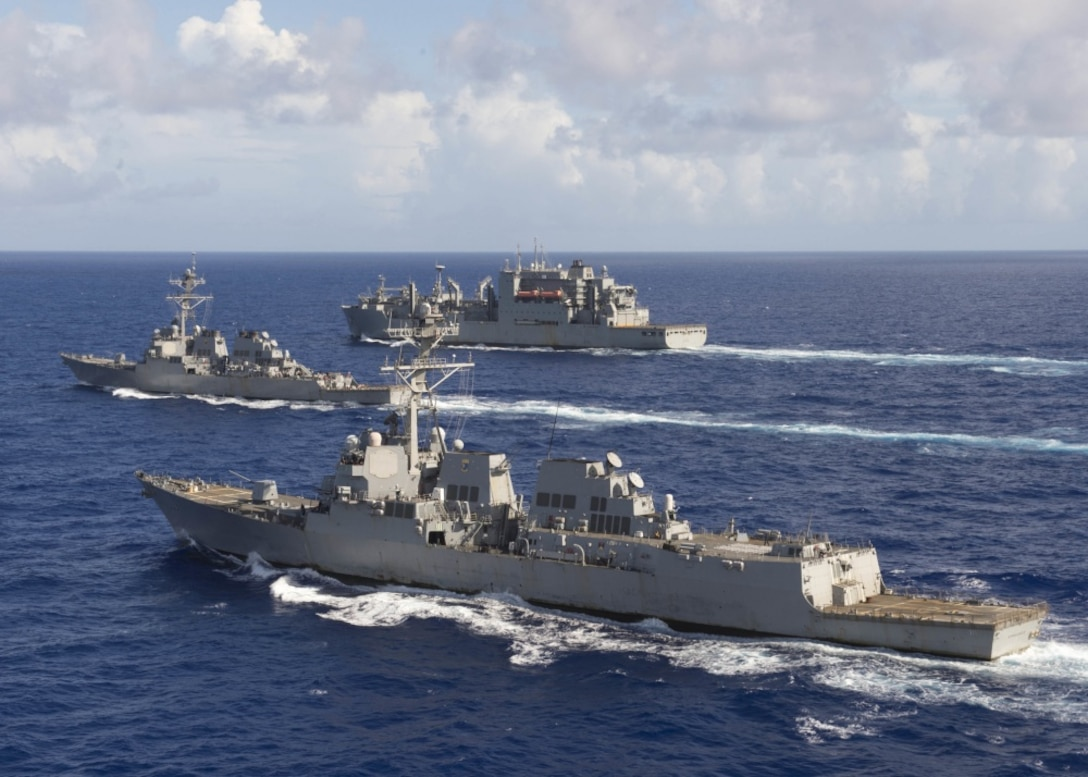"The guided-missile destroyers USS Spruance, front, USS Decatur and the Military Sealift Command fleet oiler USNS Carl Brashear steam in formation in the Pacific Ocean with the U.S. Air Force 34th Expeditionary Bomb Squadron from Anderson Air Force Base, Guam, following a joint exercise, Oct. 27, 2016. The Spruance and Decatur and the guided-missile destroyer USS Momsen, along with embarked ""Warbirds"" and ""Devilfish"" detachments of Helicopter Maritime Strike Squadron 49, are deployed in support of maritime security and stability in the Indo-Asia-Pacific region as part of a U.S. 3rd Fleet Pacific Surface Action Group under the commander of Destroyer Squadron 31. Navy photo by Petty Officer 2nd Class Will Gaskill"