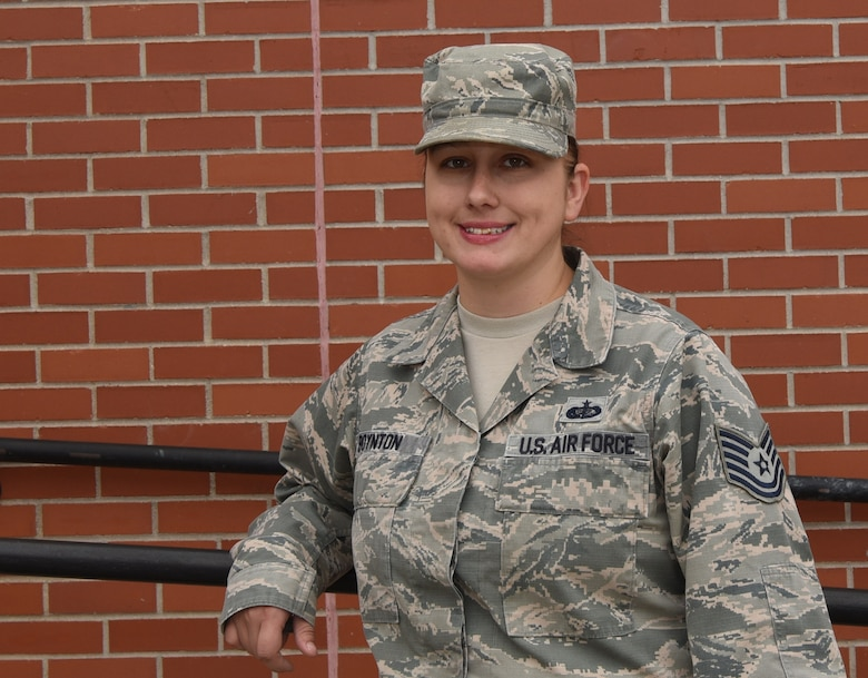 Tech Sgt. Nicole Boynton, 90th Force Support Squadron community center NCO in charge, poses outside of the Trail's End at F.E. Warren Air Force Base, Wyo., Oct. 25, 2016. Boynton plays a large role in running the Trail's End, which supports many base morale events, such as retirements, promotions, fun activities and more. (U.S. Air Force photo by Airman 1st Class Breanna Carter)
