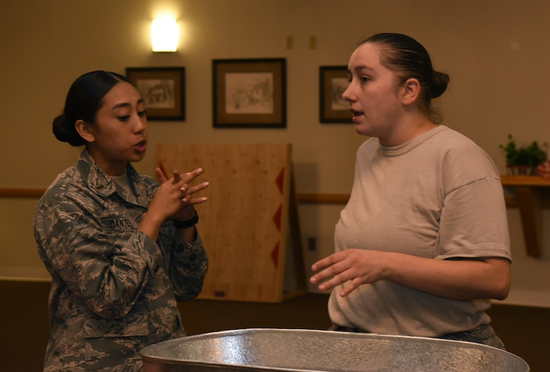 Tech Sgt. Nicole Boynton, 90th Force Support Squadron community center NCO in charge and 2nd Lt. Alyscia Dantes, 90th FSS community services deputy flight chief, discuss how to set up the ballroom in the Trail's End at F.E. Warren Air Force Base, Wyo., Oct. 27, 2016. They were planning decorations for an upcoming event. (U.S. Air Force photo by Airman 1st Class Breanna Carter)