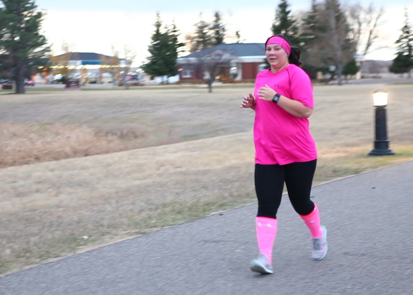 A participant of a Breast Cancer Awareness 2 mi. Run/Walk run on F.E. Warren Air Force Base, Wyo., October 25, 2016. The 90th Medical Group organized the run/walk and hosted a guest speaker later that week to commemorate October being Breast Cancer Awareness Month. (U.S. Air Force Photo by Lan Kim)