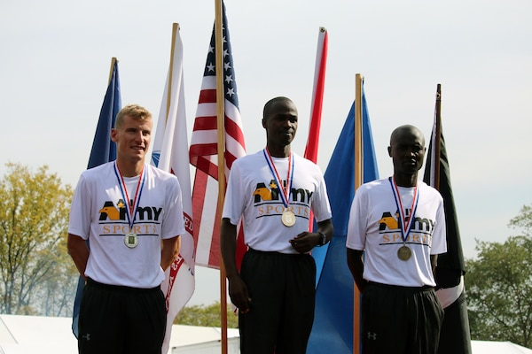 Army sweeps the podium of the Men's Individual Marathon Championship.  Left to right:  2nd Place: Capt. Kenneth Foster, Denver, Colo. - 2:28:02; 1st Place: SPC Samuel Kosgei, Fort Riley, Kan. - 2:23:53; 