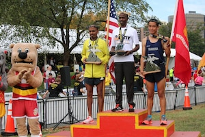 Army Spc. Samuel Kosgei (center) of Fort Riley, Kansas wins the Marine Corps Marathon for a second time with a time of 2:23:53. The 2016 Armed Forces Marathon is held in conjunction with the 41st Marine Corps Marathon on 30 October in Washington, D.C.