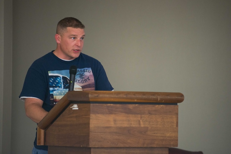 U.S. Air Force Master Sgt. Gordon Carpenter, 5th Reconnaissance Squadron section chief, speaks during an Osan Storytellers event at the Mustang Club at Osan Air Base, Republic of Korea, Oct. 26, 2016. Carpenter shared his account of resiliency as a single father and First Term Airman. Osan Storytellers is a quarterly event giving Airmen of all ranks the opportunity to share personal and military experience with other Airmen. (U.S. Air Force photo by Senior Airman Dillian Bamman)