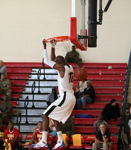 Army Spc. Mamadou Seck of Fort Stewart, Georgia hits the dunk as he led Army scoring with 21 points as Army beat Marine Corps 107-63.  The 2016 Armed Forces Men's Basketball Championship held at MCB Quantico, Va. from 1-7 November.  The best two teams during the doubel round robin will face each other for the 2016 Armed Forces crown.
