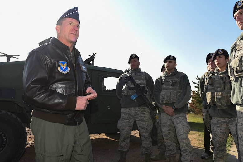 """Air Force Chief of Staff Gen. David L. Goldfein speaks with 8th Security Forces Squadron members at Kunsan Air Base, Republic of Korea, Nov. 2, 2016. 8th SFS showcased their role in the first priority of Wolf Pack's mission to, """"Defend the Base.""""  (U.S. Air Force photo by Senior Airman Michael Hunsaker/Released)"""