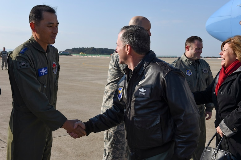 Col. Sung-Bok Lee, 38th Fighter Group commander, greets Air Force Chief of Staff, Gen. David L. Goldfein, at Kunsan Air Base, Republic of Korea, Nov. 2, 2016. Goldfein traveled to Kunsan to meet with airmen and discuss his focus areas as Air Force Chief of Staff as well as the Air Force mission throughout the Pacific region.  (U.S. Air Force photo by Senior Airman Michael Hunsaker/Released)