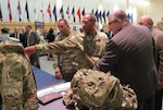Army Brig. Gen. Charles Hamilton, DLA Troop Support commander, discusses textile items with Industries for the Blind during the annual National Disability Employment Month Expo and Ability One Day event Oct. 26.