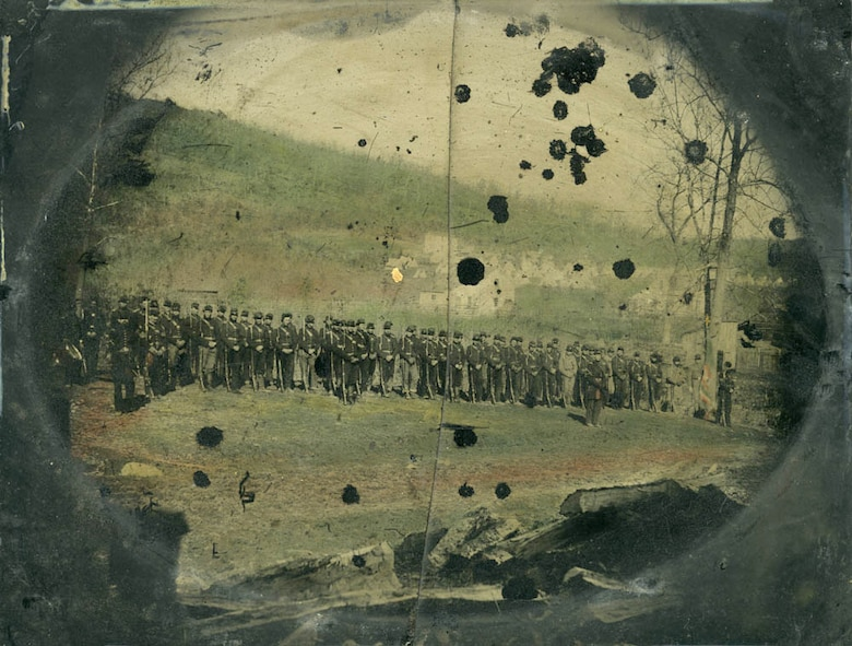 The men of Col. Josiah Bissell's Engineer Regiment of the West stand in formation. Formed in 1861 of men from Illinois, Iowa, and Missouri, the unit performed arduous service during the Vicksburg campaign excavating canals, corduroying roads and building bridges.