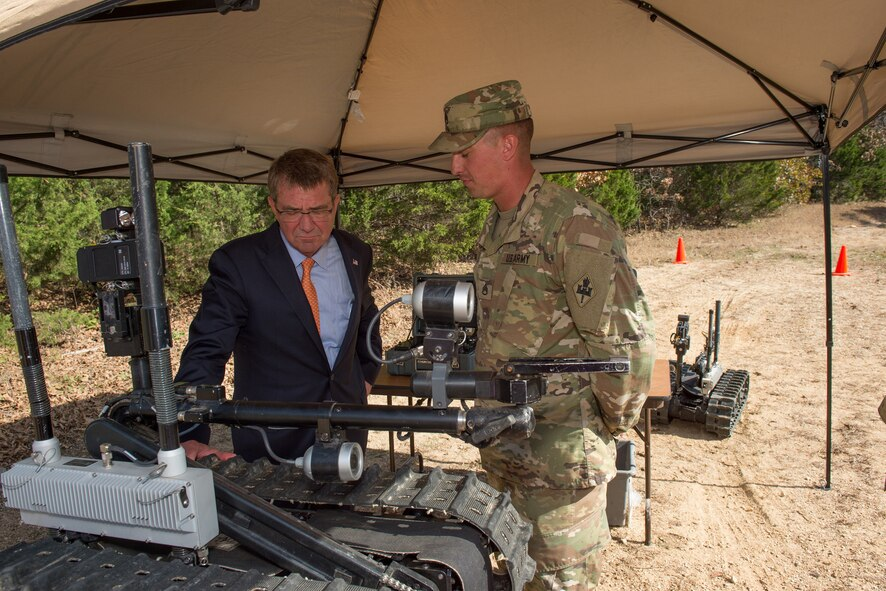 Defense Secretary Ash Carter receives a briefing on route clearance and robot operations during an exercise at Fort Leonard Wood.