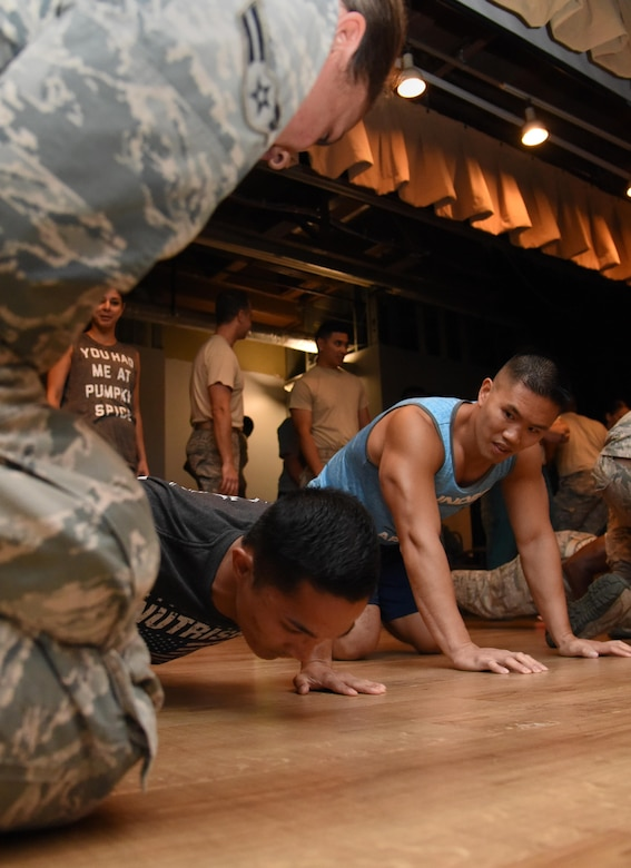 Airman 1st Class Edgardo Pangilinan, 81st Medical Operations Squadron mental health technician, and 1st Lt. Minh Tran, 81st MDOS physician assistant, compete in the 81st Medical Group Push-up Competition at the Keesler Medical Center Don Wylie Auditorium Nov. 1, 2016, on Keesler Air Force Base, Miss. Seven five-person teams competed in the event pushing out a total of 6,272 push-ups. The 81st Dental Squadron was this year's winner with 1,127 push-ups. The Airmen who participated in the event raised money to support the Krewe of Medics Mardi Gras Ball. (U.S. Air Force photo by Kemberly Groue/Released)