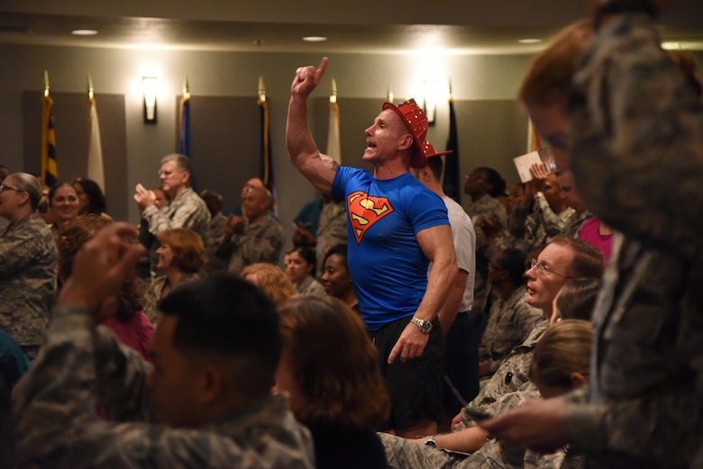 Chief Master Sgt. Karl Day, 81st Medical Group superintendent, shouts out a comment during the 81st MDG Push-up Competition at the Keesler Medical Center Don Wylie Auditorium Nov. 1, 2016, on Keesler Air Force Base, Miss. Seven five-person teams competed in the event pushing out a total of 6,272 push-ups. The 81st Dental Squadron was this year's winner with 1,127 push-ups. The Airmen who participated in the event raised money to support the Krewe of Medics Mardi Gras Ball. (U.S. Air Force photo by Kemberly Groue/Released)